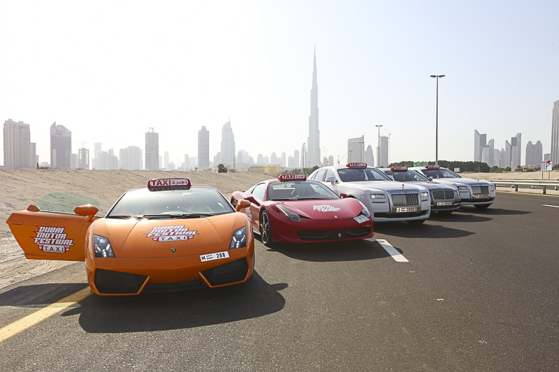 Luxury sports cars against the Dubai landscapev